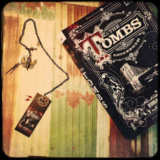 One (1) winner will receive a finished copy of The Tombs and a custom bookmark handmade by Deborah Schaumberg